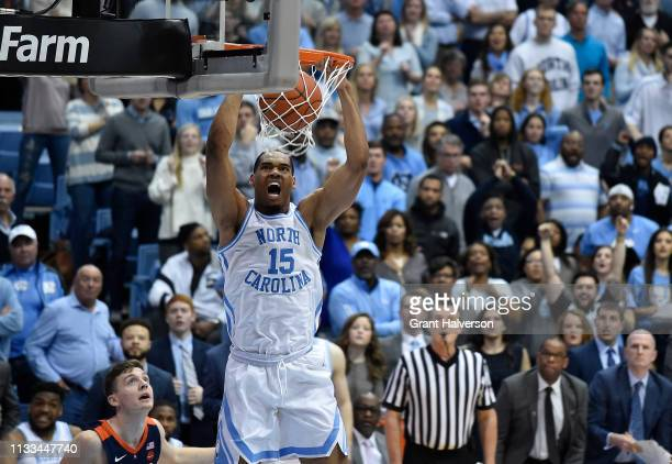 Garrison Brooks of the North Carolina Tar Heels dunks against the Virginia Cavaliers during their game at the Dean Smith Center on February 11 2019...