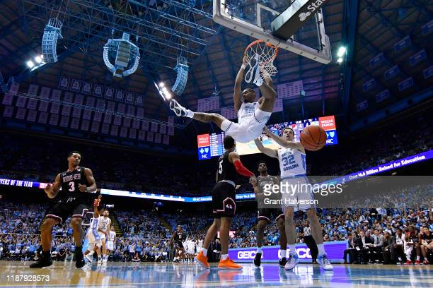 Garrison Brooks of the North Carolina Tar Heels dunks against the Gardner-Webb Runnin Bulldogs during the first half of their game at the Dean Smith...