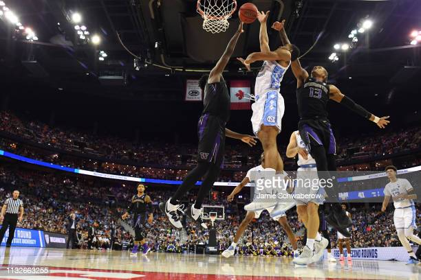 Garrison Brooks of the North Carolina Tar Heels fights for a rebound against Elijah Hardy and Hameir Wright of the Washington Huskies in the second...