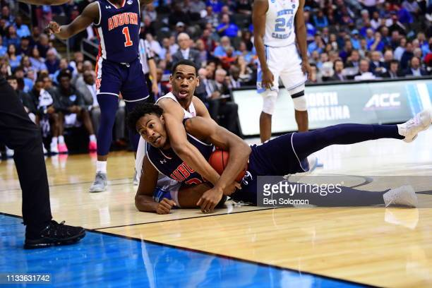 Garrison Brooks of the North Carolina Tar Heels fights over the ball against Anfernee McLemore of the Auburn Tigers in the third round of the 2019...