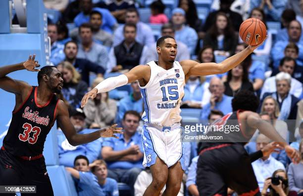 Garrison Brooks of the North Carolina Tar Heels rebounds against Luidgy Laporal of the St Francis Red Flash during the first half of their game at...