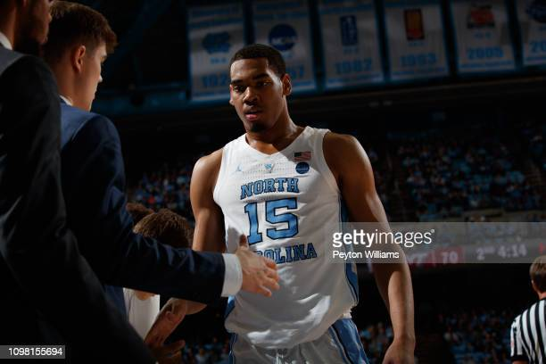 Garrison Brooks of the North Carolina Tar Heels shakes hands at the bench during a game against the Virginia Tech Hokies on January 21 2019 at the...