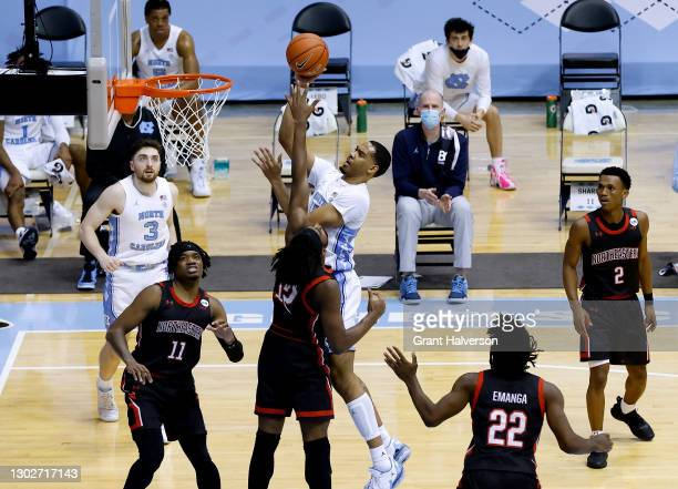Garrison Brooks of the North Carolina Tar Heels shoots over Alex Nwagha of the Northeastern Huskies during their game at the Dean Smith Center on...