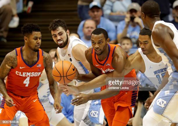 Garrison Brooks of the North Carolina Tar Heels tries to knock the ball away from Aamir Simms of the Clemson Tigers during their game at Dean Smith...