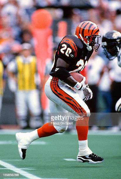 Garrison Hearst of the Cincinnati Bengals carries the ball against the Jacksonville Jaguars during an NFL football game October 27 1996 at Riverfront...