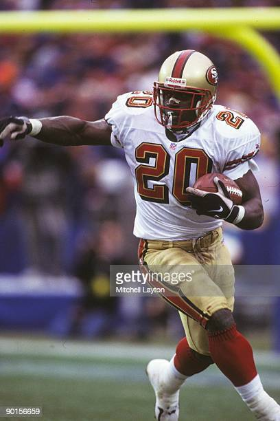 Garrison Hearst of the San Francisco 49ers runs with the ball during a NFL football game against the New England Patriots on December 20 1996 at...