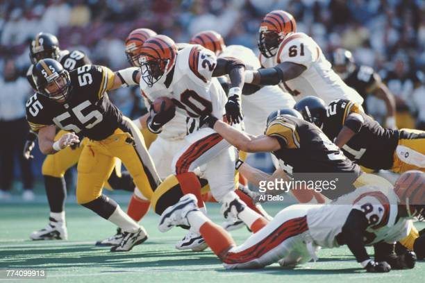 Garrison Hearst Running Back for the Cincinnati Bengals runs the ball through the Steelers during the American Football Conference Central game...