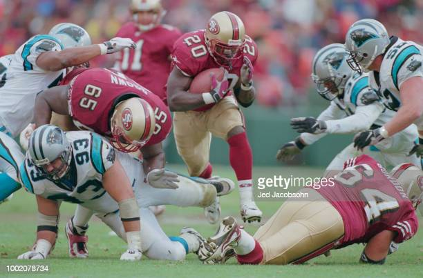 Garrison Hearst Running Back for the San Francisco 49ers iruns the ball through the Carolina Panthers defence during their National Football...