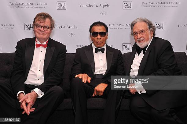 Garrison Keillor former boxing champion Muhammad Ali and Lawrence Schiller attend the Norman Mailer Center 4th Annual Benefit Gala on October 4 2012...