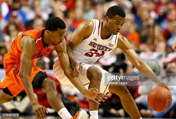 Garrius Adams of the Miami Hurricanes goes after a loose ball against TJ Warren of the North Carolina State Wolfpack during the second round of the...