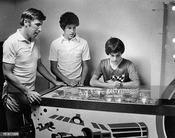AUG 18 1981 AUG 19 1981 Garry Berman and sons Rob and Randy play pinball in their home Berman joins his sons in various sports takes an interest in...