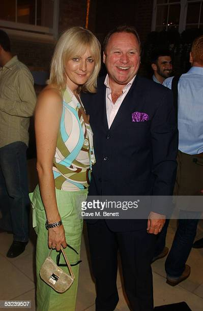 Garry Farrow and a guest attend Dylan Jones Book Launch Party of 'iPod Therefore I am'' at Asprey on July 14 2005 in London England