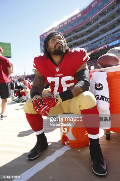 Garry Gilliam of the San Francisco 49ers sits on the sideline during the game against the Detroit Lions at Levi Stadium on September 16 2018 in Santa...
