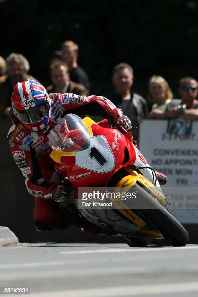 Garry Johnson takes the corner at Quarterbridge during the superbike TT race in Douglas on June 8 Isle Of Man United Kingdom The annual TT race is...