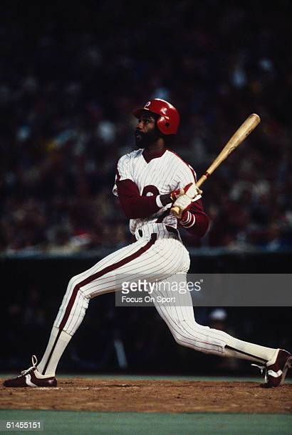Garry Maddox of the Philadelphia Phillies swings and connects against the Kansas City Royals during the World Series at Veterans Stadium in...
