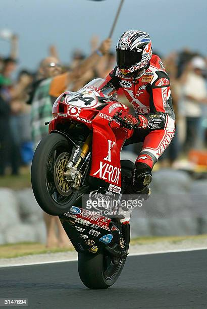 Garry McCoy of Australia and Team Xerox Ducati Nortel Networks celebrates his win in race two of round two of the 2004 Superbike World Championship,...