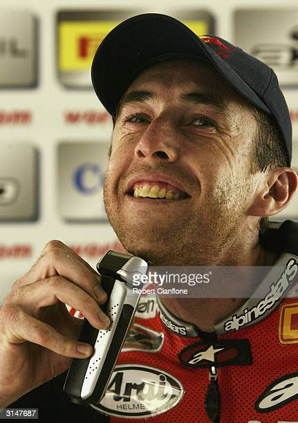 Garry McCoy of Australia trims his beard after his win in race two of round two of the 2004 Superbike World Championship, on March 28, 2004 at the...