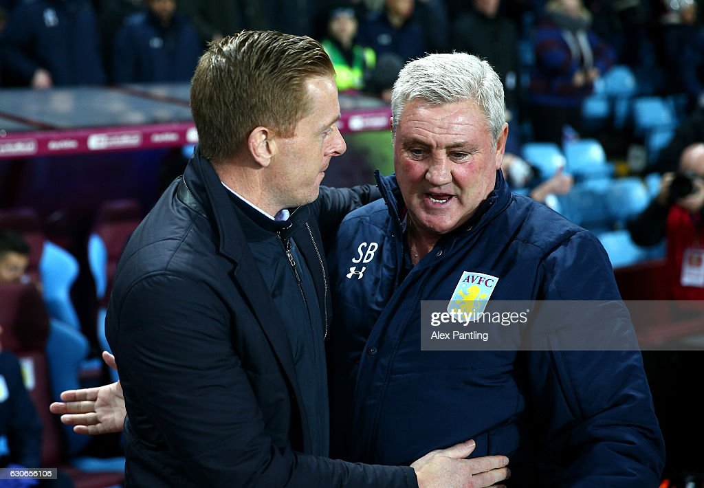 Garry Monk, Manager of Leeds United (L) and Steve Bruce, Manager of Aston Villa (R) shake hands prior to the Sky Bet Championship match between Aston Villa and Leeds United at Villa Park on December 29, 2016 in Birmingham, England.
