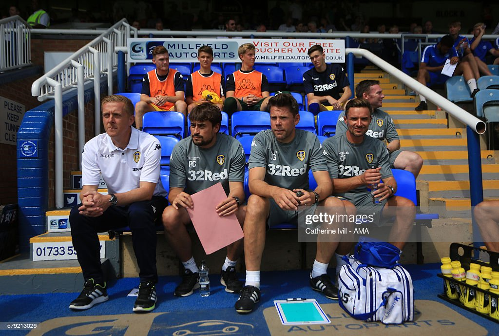 Garry Monk manager of Leeds United, assistant Pep Clotet, first team coach James Beattie and goalkeeping coach Darryl Flahavan during the Pre-Season Friendly match between Peterborough United and Leeds United at London Road Stadium on July 23, 2016 in Peterborough, England.
