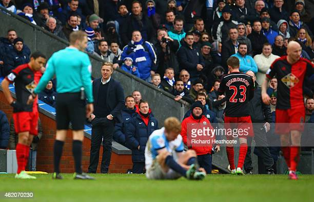 Garry Monk manager of Swansea City looks on as Gylfi Sigurdsson of Swansea City is sent off for a tackle on Chris Taylor of Blackburn Rovers during...