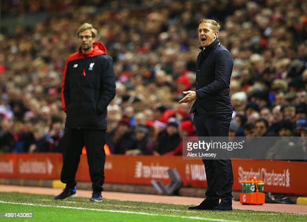 Garry Monk manager of Swansea City shouts as Jurgen Klopp manager of Liverpool looks on during the Barclays Premier League match between Liverpool...
