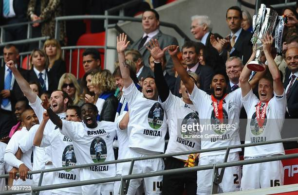 Garry Monk of Swansea lifts the trophy as they celebrate promotion to the Premier League during the npower Championship Playoff Final between Reading...