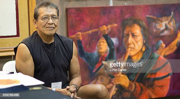 Garry Montgomery a member of the Seminole tribe displays his paintings at the Red Earth Native American Festival Friday June 10 2016 in Oklahoma City