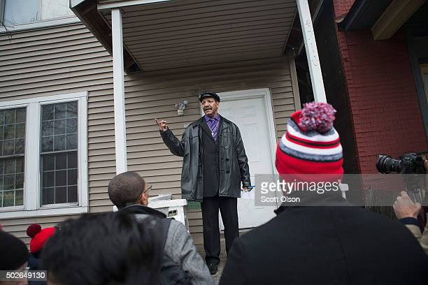 Garry Mullen the husband of Bettie Jones speaks during a vigil outside her home on December 27 2015 in Chicago Illinois Bettie Jones was shot and...
