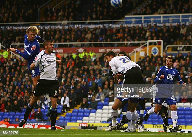 Garry O'Connor of Birmingham scores his first goal during the CocaCola Championship match between Birmingham City and Sheffield Wednesday at St...