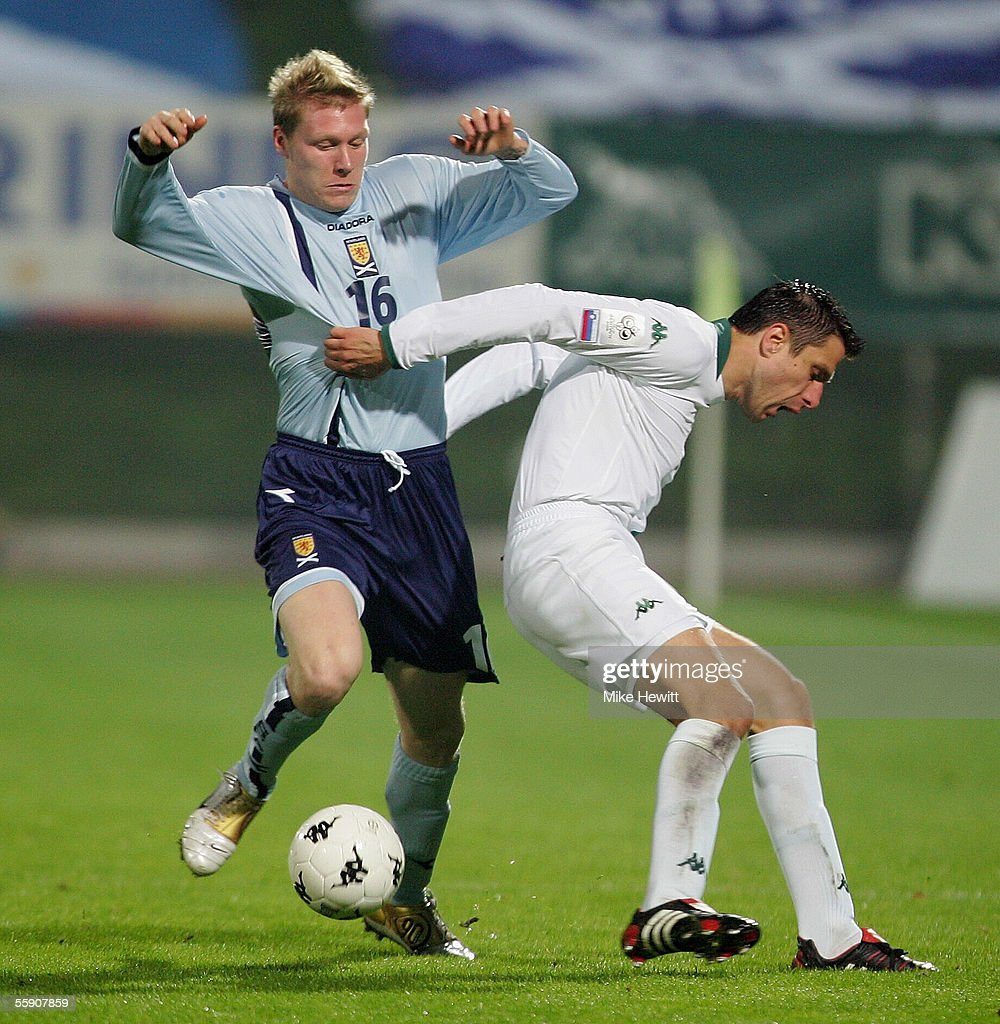 Garry O'Connor of Scotland tangles with Robert Koren of Slovenia during the FIFA World Cup group 5 qualifying match between Slovenia and Scotland on October 12, 2005 at the Petrol Arena Stadium in Celje, Slovenia.
