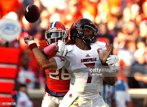 Garry Peters of the Clemson Tigers forces a fumble on Reggie Bonnafon of the Louisville Cardinals during the game at Memorial Stadium on October 11...