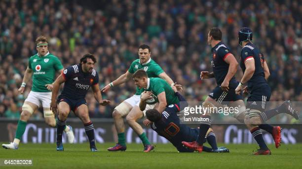 Garry Ringrose of Ireland is tackled by Camille Lopez of France during the RBS Six Nations match between Ireland and France at the Aviva Stadium on...