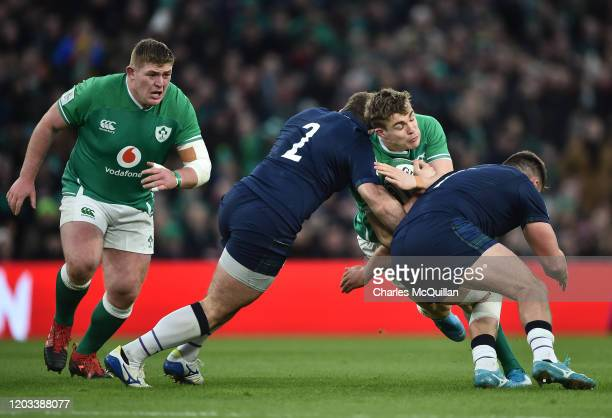 Garry Ringrose of Ireland is tackled by Fraser Brown and Rory Sutherland of Scotland during the 2020 Guinness Six Nations match between Ireland and...