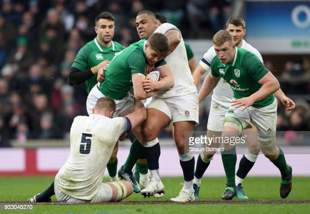Garry Ringrose of Ireland is tackled by George Kruis of England and Kyle Sinckler of England during the NatWest Six Nations match between England and...