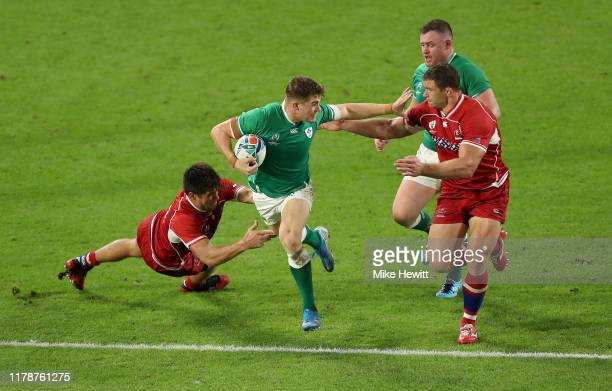 Garry Ringrose of Ireland is tackled by German Davydov while attempting to hold off Kirill Gotovtsev of Russia during the Rugby World Cup 2019 Group...