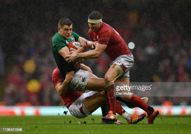 Garry Ringrose of Ireland is tackled by Owen Watkin and Dan Biggar of Wales during the Guinness Six Nations match between Wales and Ireland at the...