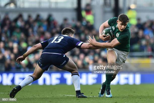 Garry Ringrose of Ireland slips past Huw Jones of Scotland during the Ireland v Scotland Six Nations rugby championship game at Aviva Stadium on...