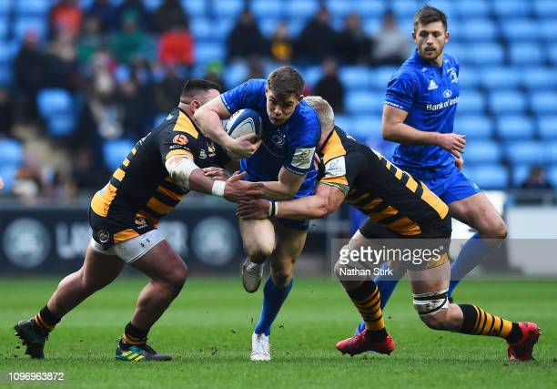 Garry Ringrose of Leinster attempts to break a tackle during the Champions Cup match between Wasps and Leinster Rugby at Ricoh Arena on January 20...