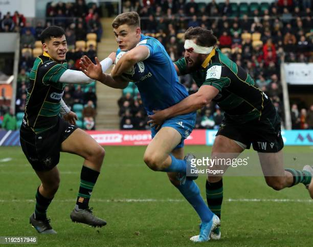 Garry Ringrose of Leinster is tackled by Connor Tupai and Tom Wood during the Heineken Champions Cup Round 3 match between Northampton Saints and...