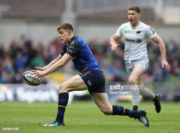 Garry Ringrose of Leinster passes the ball during the European Rugby Champions Cup quarter final match between Leinster Rugby and Saracens at the...