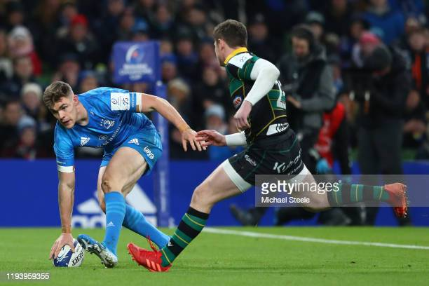 Garry Ringrose of Leinster scores a try as Fraser Dingwall of Northampton closes in during the Heineken Champions Cup Round 4 match between Leinster...