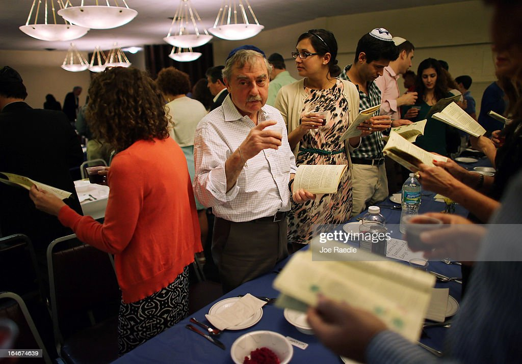 Garry Shomair and others drink a glass of wine during a community Passover Seder at Beth Israel synagogue on March 25, 2013 in Miami Beach, Florida. The community Passover Seder that served around 150 people has been held for the past 30 years and is welcome to anyone in the community that wants to commemorate the emancipation of the Israelites from slavery in ancient Egypt.