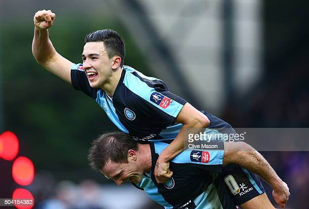 Garry Thompson and Luke O'Nien of Wycombe Wanderers celebrate their 11 draw in the Emirates FA Cup Third Round match between Wycombe Wanderers and...
