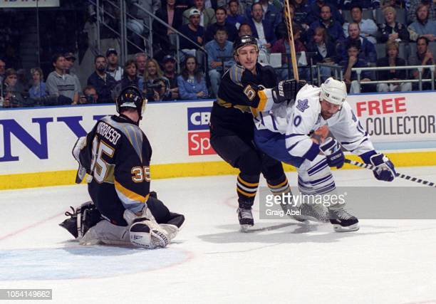 Garry Valk of the Toronto Maple Leafs skates against Tom Barrasso and Brad Werenka of the Pittsburgh Penguins during the 1999 Quarter Finals of the...