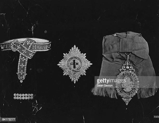 A garter star and sash badge of the Order of the Garter all bearing the order's motto 'Honi soit qui mal y pense' circa 1925 The sash badge features...