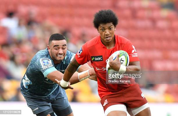 Garth April of the Sunwolves breaks away from the defence during the round seven Super Rugby match between the Sunwolves and the Crusaders at Suncorp...