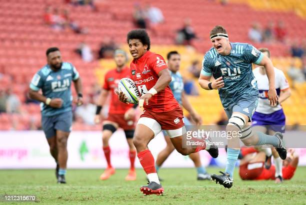 Garth April of the Sunwolves breaks through the defence during the round seven Super Rugby match between the Sunwolves and the Crusaders at Suncorp...