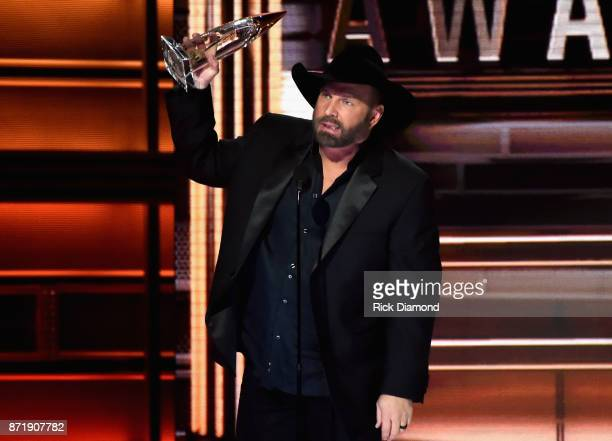 Garth Brooks accepts an award onstage at the 51st annual CMA Awards at the Bridgestone Arena on November 8 2017 in Nashville Tennessee