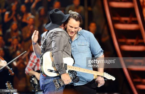 Garth Brooks and Chris Pratt speak on stage at the 2019 iHeartRadio Music Awards which broadcasted live on FOX at the Microsoft Theater on March 14...