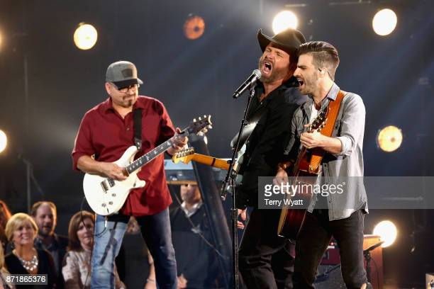 Garth Brooks and Mitch Rossell perform onstage at the 51st annual CMA Awards at the Bridgestone Arena on November 8 2017 in Nashville Tennessee